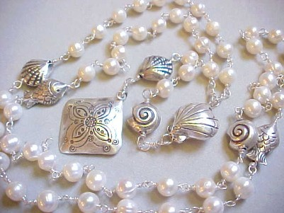 Handmade wire wrapped fresh water pearl  Rosary with Hill Tribes fish and shell beads.