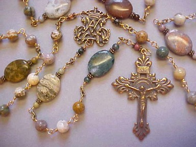 handmade bronze wire wrapped rosary with Ocean Jasper gemstones and hand cast bronze crucifix and center