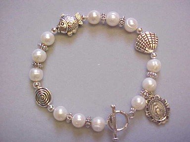 handmade Trinity bracelet with freshwater pearls and fish and shell beads