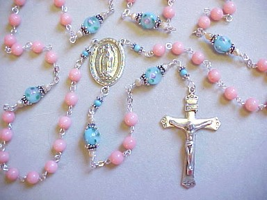 handmade sterling silver Our Lady of Guadalupe rosary with pink coral and lampworked glass