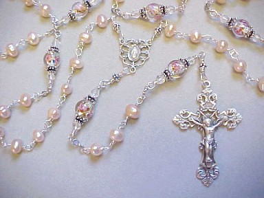 handmade wire wrapped sterling silver rosary with peach freshwater pearls and lampworked glass