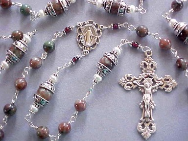handmade sterling silver wire wrapped rosary with Kashgar garnet, button pearls and deluxe sterling silver crucifix and center