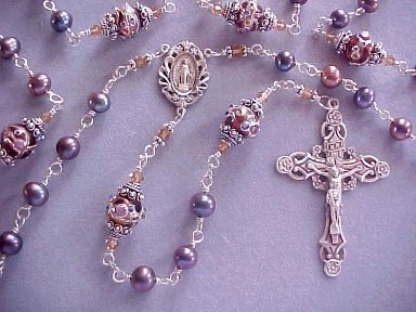 handmade sterling silver wire wrapped rosary with lilac bronze freshwater pearls, lampworked glass and deluxe sterling silver crucifix and center