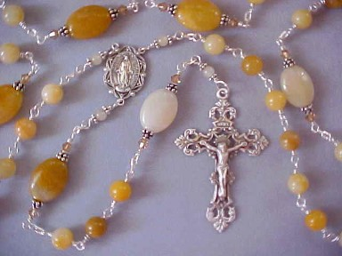 handmade sterling silver wire wrapped rosary with golden jade round beads and golden quartzite oval Our Father beads